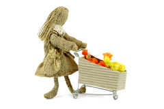 Burlap doll with shopping cart Royalty Free Stock Photos