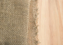 Burlap Edge and Wooden Background or Old Linen Canvas Stock Photography