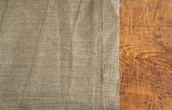 Burlap Edge and Wooden Background or Old Linen Canvas Royalty Free Stock Photos