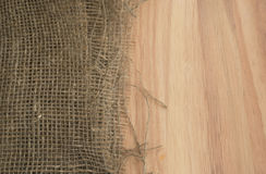 Burlap Edge and Wooden Background or Old Linen Canvas Stock Photos