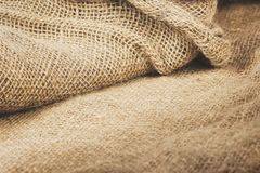 Burlap fabric draped vintage tone color for background. Stock Photography