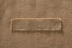 Burlap Fabric Frame Piece Label over Sack Cloth Linen Hessian stock photography