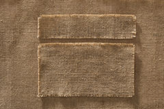 Burlap Fabric Frames Pieces Labels, Linen Cloth Patch on Hessian Royalty Free Stock Images