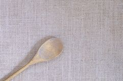 Burlap fabric with wooden spoon. Stock Photography