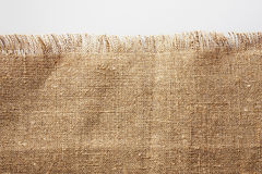 Burlap with frayed edge Stock Image