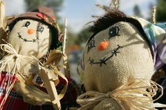 Burlap Friends. Two smiling scarecrows with burlap faces Stock Image