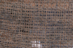Burlap gunny net. Texture of a burlap material. Hanging gunny net. Fabric background Royalty Free Stock Photography