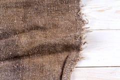 Burlap hessian grabije na drewnianym tle Zdjęcie Royalty Free
