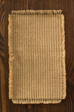 Burlap hessian sack on wood. En background stock photography