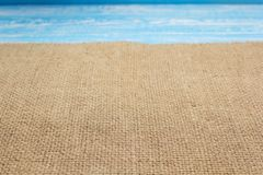 Burlap hessian sacking cloth on wooden background. Table in front view royalty free stock photos
