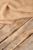 Burlap hessian sacking, top view. Sackcloth burlap on old wooden floor and copy space royalty free stock photography