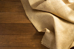 Burlap hessian sacking on wooden. Background royalty free stock photos