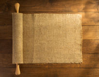 Burlap hessian sacking on wooden. Background stock images