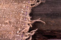 Burlap hessian sacking on wooden background. Grunge vintage backdrop. Copy space for text stock images