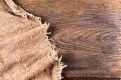 Burlap hessian sacking on wooden background. Grunge vintage backdrop. Copy space for text royalty free stock images