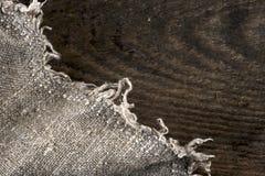 Burlap hessian sacking on wooden background Royalty Free Stock Photography