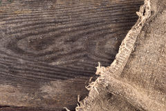 Burlap hessian sacking on wooden background Royalty Free Stock Image