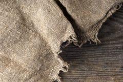 Burlap hessian sacking on wooden background Stock Image