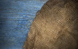 Brown burlap hemp cloth on wooden table rustic background stock photography