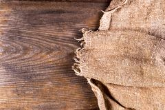Burlap hessian sacking on wooden background. Grunge vintage backdrop. Copy space for text stock photos