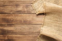 Burlap hessian sacking on wooden background. Table, top view stock image