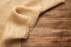 Burlap hessian sacking on wooden background. Table, top view stock photos