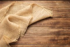 Burlap hessian sacking on wooden background. Table, top view stock photo