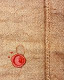 Burlap hessian sackingwith wax seal. Stock Photography