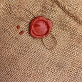Burlap hessian sackingwith wax seal. Royalty Free Stock Photo