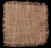 Burlap hessian square on black background Royalty Free Stock Photos