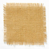 Burlap hessian square with frayed edges isolated