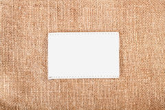 Burlap with label Royalty Free Stock Photos