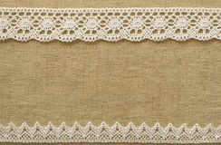 Burlap with lace. Beige burlap with white lace royalty free stock photos