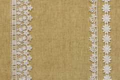 Burlap with lace. Beige burlap with white lace stock images