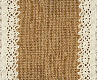 Burlap and lace. Burlap with lace edges for background stock photos