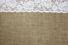 Burlap and lace texture. Burlap and white lace background royalty free stock photography