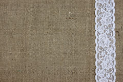Burlap and lace texture. Burlap and white lace background royalty free stock image