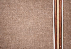 Burlap linen with wooden sticks Stock Images