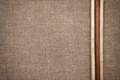 Burlap linen with wooden sticks Royalty Free Stock Image