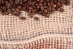 Burlap material and coffee Royalty Free Stock Photography