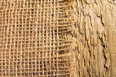 Burlap napkin on rustic wooden table Royalty Free Stock Photography