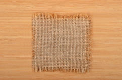 Burlap napkin on wooden background Royalty Free Stock Photo