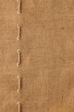 Burlap with one lines of rope Royalty Free Stock Image
