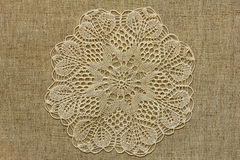 Burlap with openwork doily Stock Photos