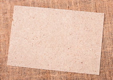 Burlap and paper background Royalty Free Stock Photos