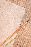 Burlap and paper with brushes Royalty Free Stock Image