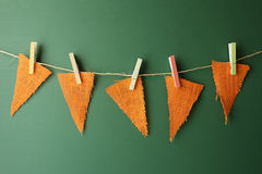 Burlap Pennants Hanging on a Green Chalkboard Stock Image