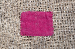 Burlap with red patch Stock Images