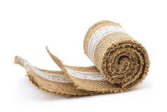 Burlap ribbon ornamented with white lace Stock Photo
