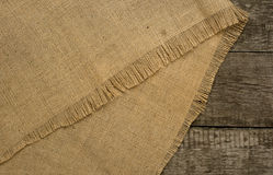 Burlap on rustic wooden background. Top view Stock Photo